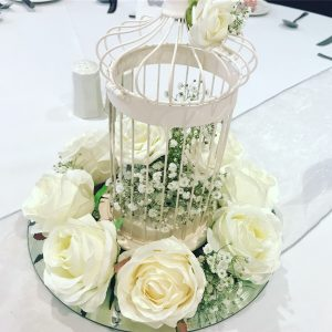 Bird cage centrepieces, roses and gyp