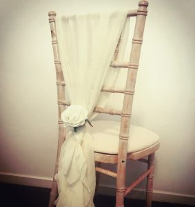 Chiavari chair decoration, ivory tie with ivory rose from Lily Special Events