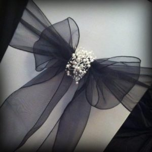 Black bow with pearl detail by Lily Special Events