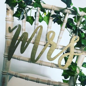 Mr and Mrs gold chair signs